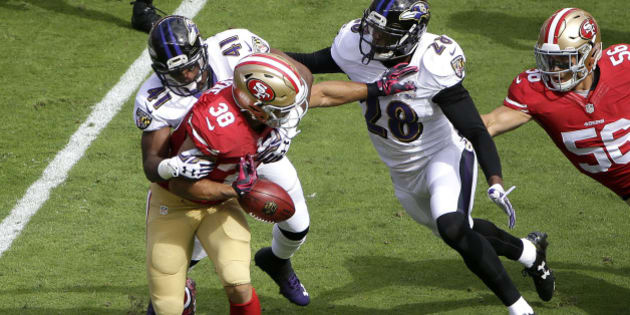 San Francisco 49ers' Jarryd Hayne (38) fumbles a punt-return while tackled by Baltimore Ravens' Anthony Levine (41) and Brynden Trawick (28) during the first half of an NFL football game in Santa Clara, Calif., Sunday, Oct. 18, 2015. The 49ers recovered the fumble. (AP Photo/Marcio Jose Sanchez)
