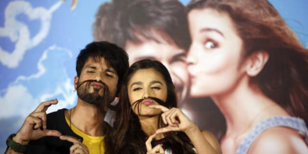 Bollywood actors Shahid Kapoor, left and Alia Bhatt pose for the media during the trailer launch of their movie 'Shaandaar' in Mumbai, India, Tuesday, Aug. 11, 2015.(AP Photo/Rajanish Kakade)