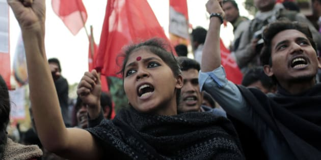 CLARIFIES THAT ACTIVISTS WERE PROTESTING COMMUNAL VIOLENCE TARGETING HINDUS. THEY WERE NOT PART OF A STRIKE BY THE OPPOSITION - Bangladeshi activists shout slogans in Dhaka, Bangladesh, Wednesday, Jan. 8, 2014 as they protest against communal attacks targeting Hindus in the wake of an election marred by low turnout and a boycott by the opposition. Political violence has convulsed the country in recent months. Nearly 300 people have been killed since last February. (AP Photo/A.M. Ahad