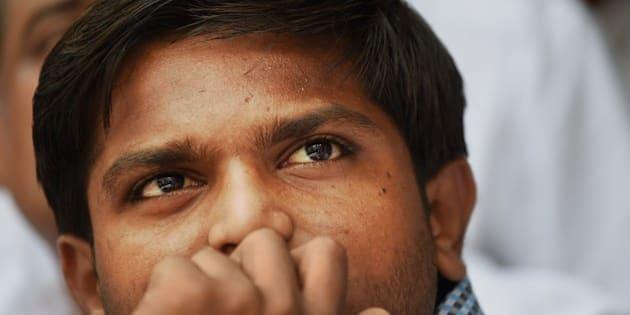 Indian convenor of the 'Patidar Anamat Andolan Samiti', Hardik Patel, who led recent protests in the state of Gujarat demanding preferential treatment regarding jobs and university places for the Patidar caste, looks on during a press conference in New Delhi on August 30, 2015. A firebrand protest leader vowed August 30 to spread agitation over caste preferences nationwide, just days after the worst violence in more than a decade in western India left nine people dead.   AFP PHOTO / SAJJAD HUSSAIN        (Photo credit should read SAJJAD HUSSAIN/AFP/Getty Images)