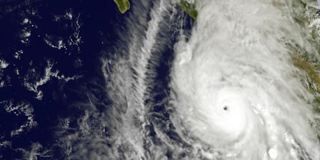 This satellite image taken at 1:45 p.m. EDT on Friday, Oct. 23, 2015, and released by NASA, shows the eastern quadrant and pinhole eye of Hurricane Patricia moving towards southwestern Mexico. The Category 5 storm is strongest ever in the Western Hemisphere, according to forecasters.  (NOAA GOES Project/NASA via AP)