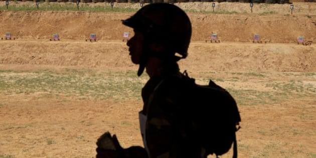 "An Indian army soldier walks past a writing on the wall ""ek goli ek dushman"" or One Bullet One Enemy at a firing range during a training session at army's Madras Engineer Group training centre in Bangalore, India, Wednesday, Oct. 14, 2015. Indian army is the world's third largest army with more than 1.3 million active troops. (AP Photo/Aijaz Rahi)"