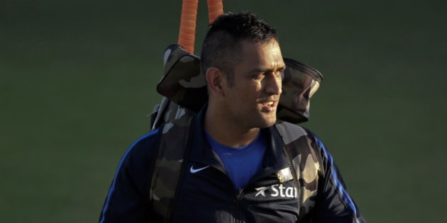 Indian cricket captain Mahendra Singh Dhoni leaves after a practice session on the eve of their first Twenty20 cricket match against South Africa in Dharmsala, India, Thursday, Oct. 1, 2015. South Africa will play three Twenty20, five one-day internationals and four test matches during their 72 day tour of India. (AP Photo /Tsering Topgyal)