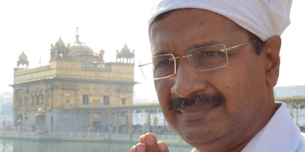 Delhi chief minister, Arvind Kejriwal pays his respects at the Golden temple in Amritsar on October 24, 2015.  Kejriwal visited the Sikh Shrine to pray for peace and harmony following the death of two people during police firing to control a crowd protesting against the alleged desecration of a Guru Granth Sahib, the holy book of Sikhs, before travelling on to Kotkapura to visit the families of the deceased.  AFP PHOTO/ NARINDER NANU        (Photo credit should read NARINDER NANU/AFP/Getty Images)