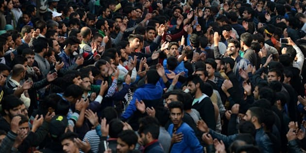 Kashmiri Shiite Muslim devotees shout religious slogans during a religious procession held ahead of Ashura on the ninth day of Muharram in Srinagar on October 23,2015. Ashura mourns the death of Imam Hussein, a grandson of the Prophet Mohammed, who was killed by armies of the Yazid near Karbala in 680 AD. AFP PHOTO/Tauseef MUSTAFA        (Photo credit should read TAUSEEF MUSTAFA/AFP/Getty Images)