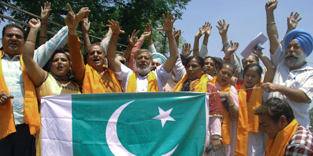 Activists of India's Shiv Sena organization burn a Pakistani flag during a demonstration in Amritsar on May 4, 2013, as they protest against the Pakistani government and the Pakistani inmates who attacked Indian prisoner Sarabjit Singh. Sarabjit Singh, an Indian convicted 16 years ago in Pakistan for spying and deadly bombings, died May 2, after being beaten in a Lahore prison, sparking a furious response from Indian politicians.   AFP PHOTO/NARINDER NANU        (Photo credit should read NARINDER NANU/AFP/Getty Images)