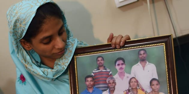 Indian woman, Geeta holds a photograph, possibly of her family, at the Edhi Foundation in Karachi on October 15, 2015.  A mute and deaf Indian girl who has been stuck in Pakistan for more than a decade because she cannot remember where she came from may have finally identified her family, the charity looking after her said. The new ray of hope for the woman known only as Geeta, believed to be in her early 20s, came after the Indian High Commission in Islamabad sent her a photograph of a family, whom she said she recognised.   AFP PHOTO/ RIZWAN TABASSUM        (Photo credit should read RIZWAN TABASSUM/AFP/Getty Images)