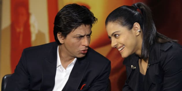 Indian actors Shah Rukh Khan, left, and Kajol Devgan talk to one another during a press conference as a trailer for their film 'My Name is Khan' is shown to an audience at a central London hotel, Wednesday, Feb. 3, 2010. (AP Photo/Joel Ryan)