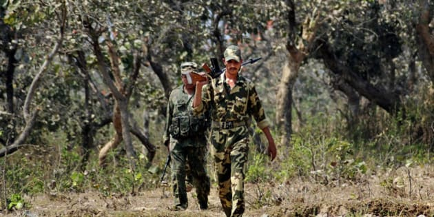 """An Indian paramilitary soldier patrols during a combing operation under """"Operation Green Hunt"""" near Rangamati, about 90 kilometers (56 miles) east of Ranchi, India, Monday, March 15, 2010. A major drive has been launched to flush out Maoist rebels, also known as Naxals, from their strongholds in West Bengal and Jharkhand state under the operation. The rebels have fought for more than four decades in several Indian states, demanding land and jobs for agricultural laborers and the poor. About 2,000 people, including police, militants and civilians, have been killed in violence over the past few years. (AP Photo/Sasanka Sen)"""