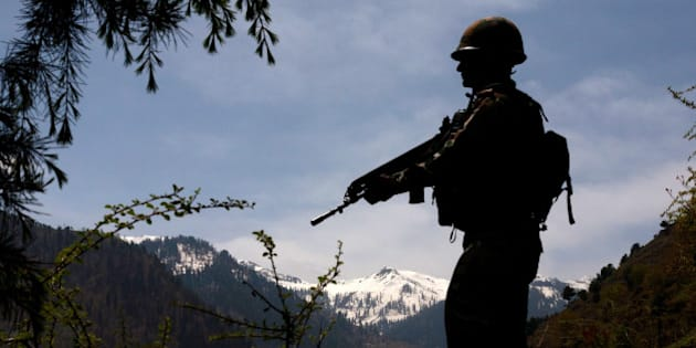 GOHALAN, KASHMIR, INDIA - APRIL 20: An Indian army soldier is silhouetted against the snow capped mountains of Pakistan administered Kashmir as he guards the the Line Of Control on April 20, 2015 in Gohalan, 120 Kms (75 miles) north west of Srinagar , the summer capital of Indian administered Kashmir, India. People living along the ceasefire line dividing Kashmir into India and Pakistan-administered portions have continually been at risk due to hostility between the armies of the two nuclear rivals. India on Sunday alledged a ceasefire violation by Pakistan along what New Delhi prefers to call the International Border and Working Boundary by Islamabad, snaking the southern Jammu region of the disputed area. The Indian army in northern Uri district say it has increased its vigil along the Line of Control (LOC), another military line that further divides the region up to the Siachen glaciers. Both Pakistan and India have traded blame over unprovoked shelling which India says is aimed to facilitate the crossover of rebels to their side, a charge Pakistan denies. (Photo by Yawar Nazir/Getty Images)
