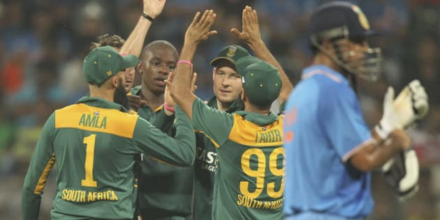 South African players celebrate the wicket of India's Axar Patel, during the final one-day international cricket match of a five-game series in Mumbai, India, Sunday, Oct. 25, 2015. (AP Photo/Rafiq Maqbool)