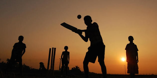 Indian boys play cricket during the last sunset for 2008 in Joypur near Agartala, the state capital of India's northeastern state of Tripura, on December 31, 2008. As the Earth rolled towards 2009, the world prepared to turn its back on a turbulent 2008 with New Year celebrations ranging from the spectacular to the sombre. AFP PHOTO/STR (Photo credit should read STR/AFP/Getty Images)