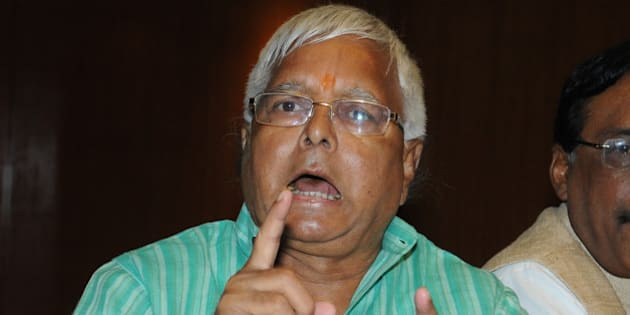 PATNA, BIHAR, INDIA - OCTOBER 8: RJD Chief Lalu Yadav addresses a press conference along with JD (U) and Congress leaders on October 8, 2015 in Patna, India. RJD Chief Lalu Prasad today challenged Prime Minister Narendra Modi to prove that he had made the 'shaitan' (devil) on his tongue comment or else seek apology from the people of Bihar for insulting them through this barb on him. (Photo by AP Dube/Hindustan Times via Getty Images)