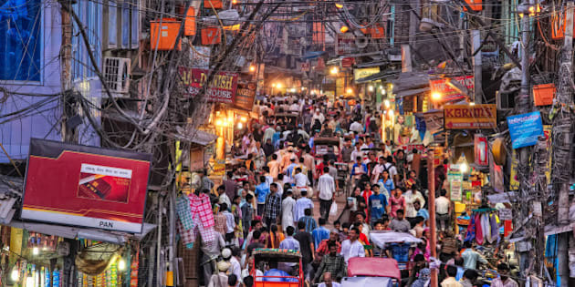 A street full of people near Jama Masjid in Old Delhi, Delhi, India. Electricity wiring in Old Delhi is a mess.