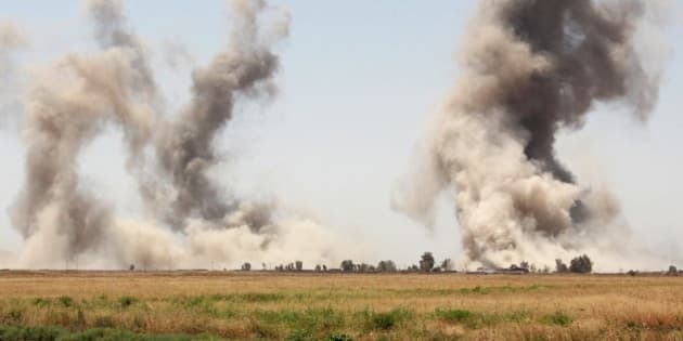 KIRKUK, IRAQ - AUGUST 17: Smoke rises after the air craft belonging to the US-led coalition bombed the areas according to the coordinates given by the Peshmerga forces in the village of Elbunecm, 44km south of Kirkuk, Iraq on August 17, 2015. The distance between Peshmerga forces and Daesh became 900m. (Photo by Hazar Rashd Hameed/Anadolu Agency/Getty Images)
