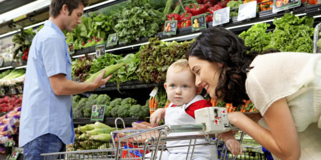 Parents with daughter (9-12 months) in supermarket