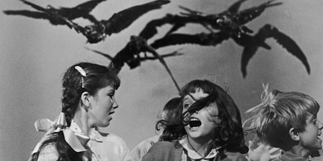 A group of schoolchildren flail about in terror at the avian attack in a publicity still for 'The Birds', directed by Alfred Hitchcock for Universal, 1963. (Photo by Archive Photos/Getty Images)