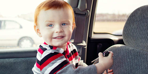 Young boy taking the keys to the family car
