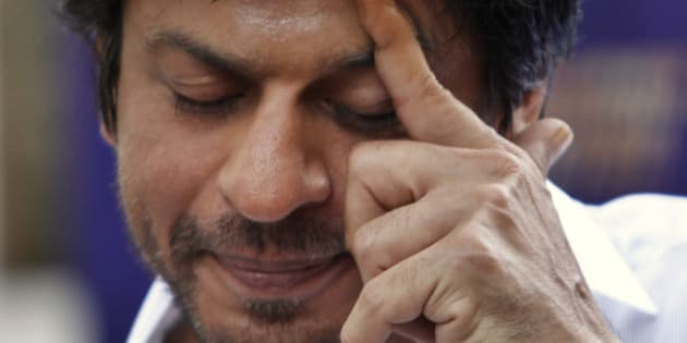 Kolkata Knight Riders team co-owner and Bollywood star Shah Rukh Khan gestures during a press conference at his residence in Mumbai, India, Wednesday, May 30, 2012. Kolkata Knight Riders won the Indian Premier League (IPL) cricket title on Sunday, defeating two-time defending champion Chennai Super Kings by five wickets in a high-scoring final. (AP Photo/Rafiq Maqbool)