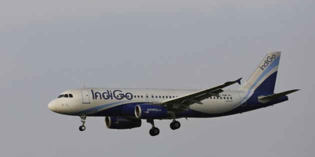 In this Thursday, April 16, 2015 photo, India's budget airline IndiGo approaches for landing at the Indira Gandhi International (IGI) Airport in New Delhi, India. (AP Photo/Altaf Qadri)