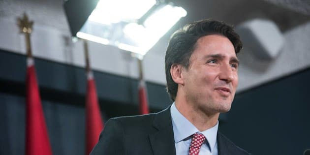Canadian Liberal Party leader Justin Trudeau speaks at a press conference in Ottawa on October 20, 2015 after winning the general elections.  Liberal leader Justin Trudeau reached out to Canada's traditional allies after winning a landslide election mandate to change tack on global warming and return to the multilateralism sometimes shunned by his predecessor.   AFP PHOTO/NICHOLAS KAMM        (Photo credit should read NICHOLAS KAMM/AFP/Getty Images)