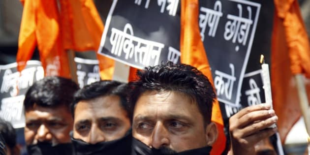 Hindu nationalist Shiv Sena party activists participate in a protest against Pakistan after Sarabjit Singh, a convicted Indian spy who was on Pakistan's death row, died from a head injury after two inmates attacked him with a brick in a Lahore jail, in Jammu, India, Thursday, May 2, 2013. Indian Prime Minister Manmohan Singh said his government would arrange to bring Singh's remains home and for his last rites to be conducted in consultation with his family. Singh was arrested in 1990 after bombings in Lahore and Faisalabad that killed 14 people and was convicted of spying and carrying out the bomb blasts, and the death sentence he received was upheld in Pakistani superior courts. (AP Photo/Channi Anand)
