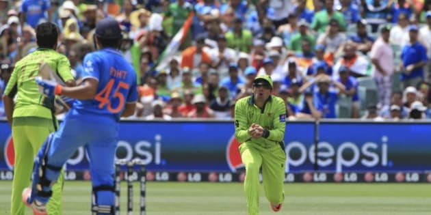 Pakistan captain Misbah-ul-Haq, takes a catch to dismiss India's Rohit Sharma during the World Cup Pool B match in Adelaide, Australia, Sunday, Feb. 15, 2015. (AP Photo/James Elsby)