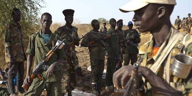 Sudan People's Liberation Army (SPLA) soldiers take a rest outside the United Nations Mission in South Sudan (UNMISS) base in Malakal on March 20, 2014, after the SPLA allegedly took over Malakal town. Malakal is a key city in an oil-prducing region in the country's northeast, 497km north of Juba. South Sudan's government has been at war with rebel groups since December 15, whena clash between troops loyal to President Salva Kiir and those loyal to sacked vice president Riek Machar snowballed into full-scale fighting. Thousands have died in more than three months fo fighting and over 930,000 civilians have fled their homes, including over a quarter of a million leaving for neighbouring nations as refugees, according to the United Nations.AFP PHOTO / IVAN LIEMAN        (Photo credit should read Ivan Lieman/AFP/Getty Images)