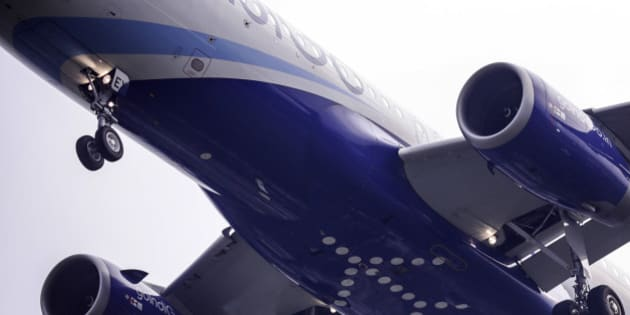 A logo sits on the underside of the fuselage of an Airbus SAS A320 aircraft operated by IndiGo, owned by Interglobe Enterprises Ltd., as it approaches the runway to land at Chhatrapati Shivaji International Airport in Mumbai, India, on Monday, Oct. 26, 2015. IndiGo, India's biggest airline by market share, is scheduled to release an initial public offering (IPO) on Oct. 27. Photographer: Dhiraj Singh/Bloomberg via Getty Images