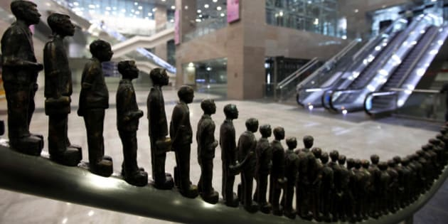 Sculptures in the likeness of passengers stand on display at the Delhi Metro Airport Express Line station in New Delhi, India, Saturday, Feb. 5, 2011. The metro line linking New Delhi Metro Station to the Indira Gandhi International Airport began services Saturday and plan to offer passengers the facility to check-in at metro stations. (AP Photo/Mustafa Quraishi)