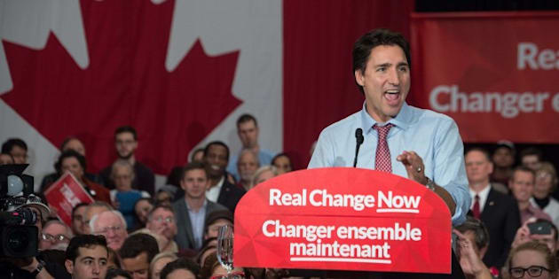 Canadian Liberal Party leader Justin Trudeau speaks at a victory rally in Ottawa on October 20, 2015 after winning the general elections.  Liberal leader Justin Trudeau reached out to Canada's traditional allies after winning a landslide election mandate to change tack on global warming and return to the multilateralism sometimes shunned by his predecessor.   AFP PHOTO/ NICHOLAS KAMM        (Photo credit should read NICHOLAS KAMM/AFP/Getty Images)