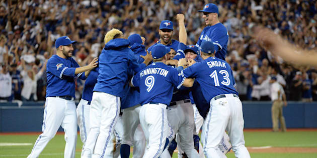 TORONTO, CANADA - OCTOBER 14:  The Toronto Blue Jays celebrate after winning Game 5 of the ALDS against the Texas Rangers at the Rogers Centre on Wednesday, October 14, 2015 in Toronto, Canada. (Photo by Jon Blacker/MLB Photos via Getty Images)