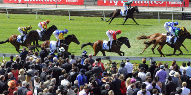 Large crowds watch Race 1 during Melbourne Cup Day at Flemington Racecourse, in Melbourne, Australia, Tuesday, Nov. 3, 2009.  ( AP Photo/Andrew Brownbill)