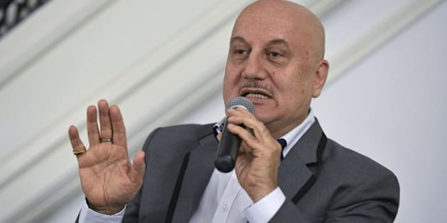 From left: Indian actors Anupam Kher takes part in a discussion on the links between Indian theater and cinema at Embassy of India on August 20, 2015 in Washington, DC. AFP PHOTO/MANDEL NGAN        (Photo credit should read MANDEL NGAN/AFP/Getty Images)