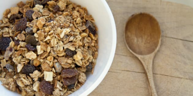 Bowl of organic muesli with nuts and spoon