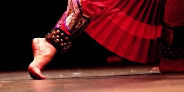 An Indian classical dancer's feet moving during her performance.