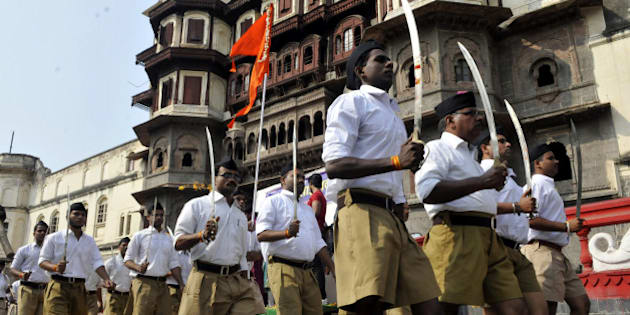 INDORE, INDIA - OCTOBER 22: RSS volunteers queue up for Dussehra Path Sanchalan at Jehangirabad area on October 22, 2015 in Indore, India. The rightwing nationalist organization RSS was founded in September 1925 by Keshav Baliram Hedgewar on Dussehra day. Rashtriya Swayamsevak Sangh (RSS) is the ideological parent of ruling party BJP. Prime Minister Narendra Modi also at one time of career served as a RSS pracharak. (Photo by Arun Mondhe/Hindustan Times via Getty Images)