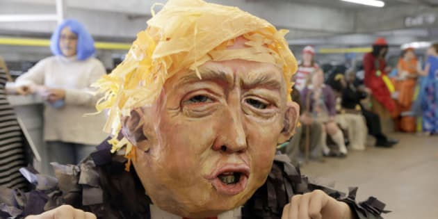 "Alia Yusuf wears a ""Donald Trump"" mask before the taping of a Halloween themed television show at Warner Bros. Studio in Burbank, Calif., on Thursday, Oct. 29, 2015. (AP Photo/Nick Ut)"