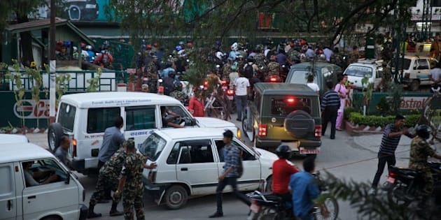 KATHMANDU, NEPAL - SEPTEMBER 30 :  Cars and motorbikes line up as drivers wait for the opening of a fuel pump at a petrol station in Kathmandu on September 30, 2015. Nepalese are facing an acute crisis of petroleum products and other essential commodities after neighboring India has stopped supplies. (Photo by Mithila Jariwala/Anadolu Agency/Getty Images)