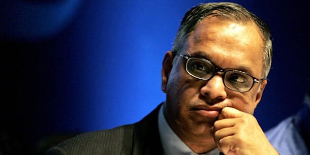 Bangalore, INDIA:  The chairman and chief mentor of the India's second largest sofTware exporter firm, Infosys Technologies, N.R.Narayanamurthy gestures during the 25th Annual General Meeting of the company in Bangalore, 10 June 2006.  Infosys was started in 1981 with a capital of US $250, and this year as the company is celebrating its 25th year, it has crossed the US $2 billion mark.  AFP PHOTO/Dibyangshu SARKAR  (Photo credit should read DIBYANGSHU SARKAR/AFP/Getty Images)