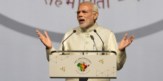 NEW DELHI, INDIA - OCTOBER 29: Prime Minister Narendra Modi addresses the African Heads of State and leaders during the India-Africa Forum Summit at Indira Gandhi Sports Complex on October 29, 2015 in New Delhi, India. Prime Minister Narendra Modi called for a united voice from India and Africa seeking UN reforms and offered the continent of 54 nations $10 billion in additional concessional credit. Modi spelled out his vision for the future of his country's economic relations with Africa. (Photo by Sonu Mehta/Hindustan Times via Getty Images)