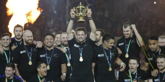 New Zealand's captain Richie McCaw holds the trophy aloft after the Rugby World Cup final between New Zealand and Australia at Twickenham Stadium in London,  Saturday, Oct. 31, 2015.  The All Blacks won 34-17. (AP Photo/Christophe Ena)