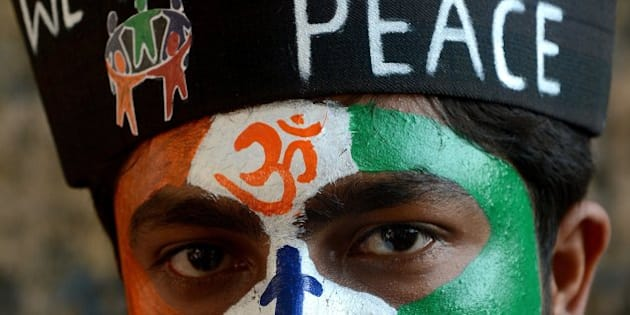 An Indian student with a peace message painted on his face attends a peace rally on the 65th death anniversary of 'father of the nation' Mahtama Gandhi, in Mumbai on January 30, 2013. Students and people from various walks of life took part in the rally for peace and communal harmony. AFP PHOTO/Indranil MUKHERJEE        (Photo credit should read INDRANIL MUKHERJEE/AFP/Getty Images)