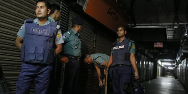 Bangladeshi security officers stand guard at the site where the slaughtered body of Faisal Arefin Deepan was found in Dhaka, Bangladesh, Saturday, Oct. 31, 2015. The publisher of secular books was hacked to death and three other people were wounded in two separate attacks Saturday at publishing houses in Bangladesh's capital, police said. Both of the publishers involved in Saturday's attacks had published works of Bangladeshi-American blogger and writer Avijit Roy, who was hacked to death on the Dhaka University campus while walking with his wife in February. (AP Photo/A.M. Ahad)