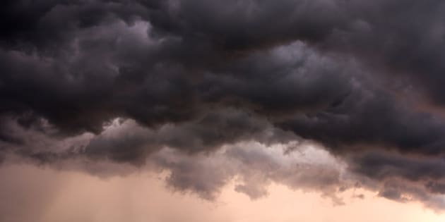 Swirling clouds during a summer storm at dusk.