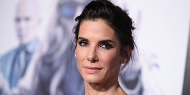 "FILE - In this Monday, Oct. 26, 2015 file photo, actress Sandra Bullock arrives at the LA Premiere of ""Our Brand is Crisis"" held at the TCL Chinese Theatre, in Los Angeles. When Bullock read the unproduced screenplay for the movie, she decided to call longtime friends George Clooney and Grant Heslov to see if there was any chance they might consider her for the lead - an amoral, Sun Tzu-quoting political consultant who's come out of retirement for a showdown with an old rival. They said yes. The film opens Friday, Oct. 30. (Photo by Richard Shotwell/Invision/AP)"