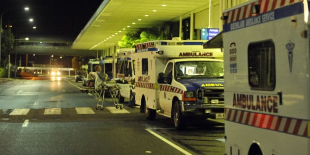 Ambulances are lined up outside the International Terminal as hospitals are being evacuated to Brisbane ahead of Cyclone Yasi at Cairns Airport on February 2, 2011. The severe catagory 4 storm is expected to reach landfall between Cairns and Townsville on February 2.      AFP PHOTO / Paul CROCK (Photo credit should read PAUL CROCK/AFP/Getty Images)