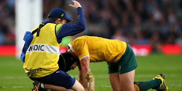 LONDON, ENGLAND - OCTOBER 31:  Matt Giteau of Australia receives treatment for an injury during the 2015 Rugby World Cup Final match between New Zealand and Australia at Twickenham Stadium on October 31, 2015 in London, United Kingdom.  (Photo by Dan Mullan/Getty Images)