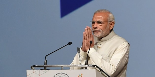 Indian Prime Minister Narendra Modi gestures as he prepares to address delegates during the India-Africa Forum Summit in New Delhi on October 29, 2015. Indian Prime Minister Narendra Modi will spell out his vision for the future of his country's economic relations with Africa, as he addresses the major India-Africa Forum Summit in New Delhi. AFP PHOTO / Money SHARMA        (Photo credit should read MONEY SHARMA/AFP/Getty Images)