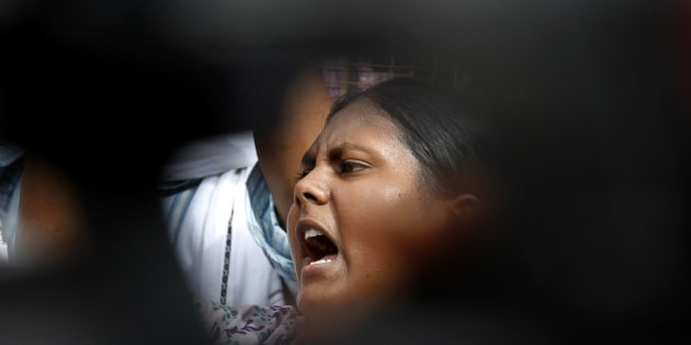 A member of Jawaharlal Nehru University Students Union shouts slogans during a protest against a gang rape of two teenage girls in Katra village, outside the Uttar Pradesh state house, in New Delhi, India, Friday, May 30, 2014. A top government official said the northern Uttar Pradesh state has sacked two police officers who failed to respond to a complaint by the father of the two teenage girls who went missing and were later found gang raped and killed. (AP Photo/Manish Swarup)